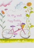 WIFE-BICYCLE AND FLOWERS